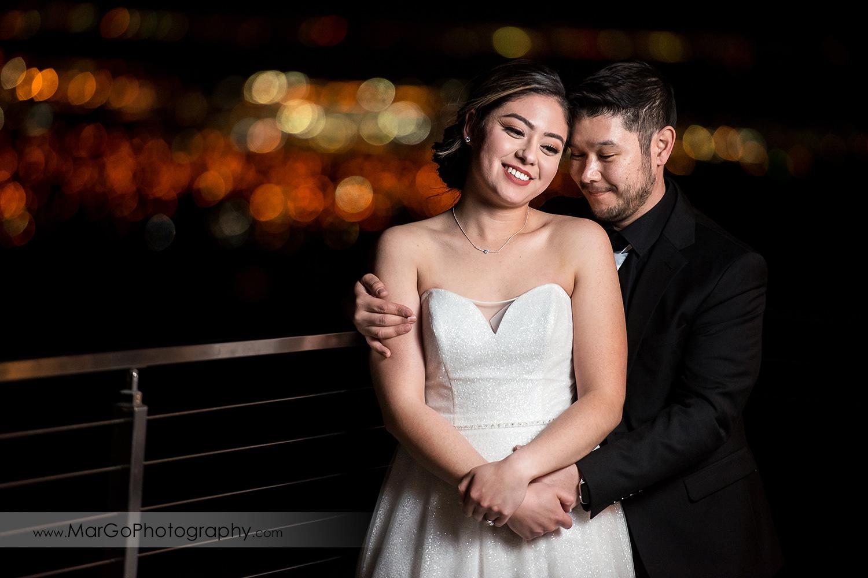 bride and groom with San Jose city lights at Mt Hamilton GrandView Restaurant
