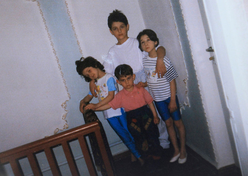 . A photo showing Dzhokhar (C, bottom) and Tamerlan (C, top) Tsarnaev, accompanied by their sisters, is seen in this photo provided by the Suleimanova family in Makhachkala April 22, 2013. Dzhokhar Tsarnaev, 19, an ethnic Chechen college student suspected of carrying out the attacks with his older brother, lay in a Boston hospital under armed guard. He was unable to speak after he was captured with throat injuries sustained during shoot-outs with police. The badly wounded Boston Marathon bombing suspect faced federal charges as early as Monday and the city of Boston planned tributes to the dead after a week of blasts, shootouts, lockdowns and one of the largest manhunts in U.S. history. The photo shows Dzhokhar and Tamerlan Tsarnaev, accompanied by their sisters. REUTERS/Courtesy of Suleimanova family/Handout