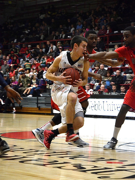 Max Landis(10) keeps the ball tight to keep Radford from getting it.
