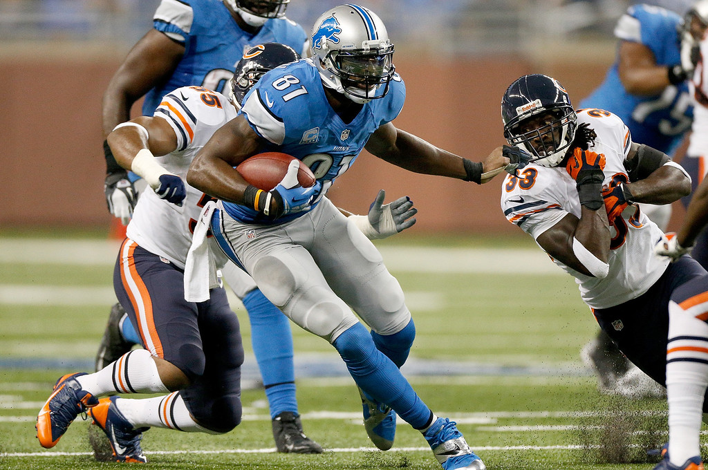. DETROIT, MI - SEPTEMBER 29: Calvin Johnson #81 of the Detroit Lions stiff arms Charles Tillman #33 of the Chicago Bears at Ford Field on September 29, 2013 in Detroit, Michigan. (Photo by Gregory Shamus/Getty Images)
