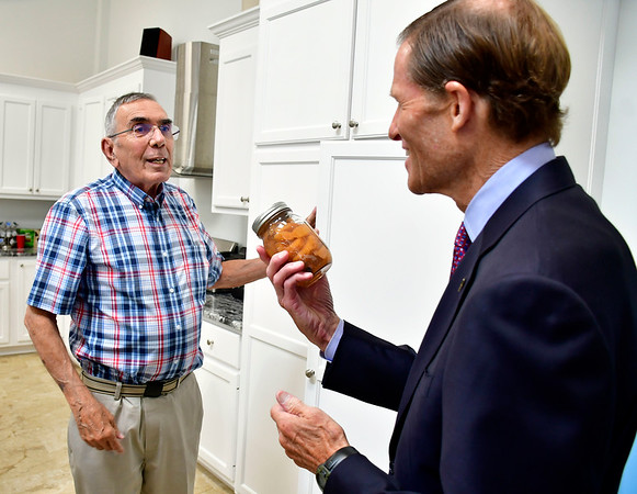 7/26/2019 Mike Orazzi | Staff U.S. Sen. Richard Blumenthal receives a jar of canned peaches from Pepco President Bob Sposato on Lake Avenue in Bristol during a factory tour on Friday.