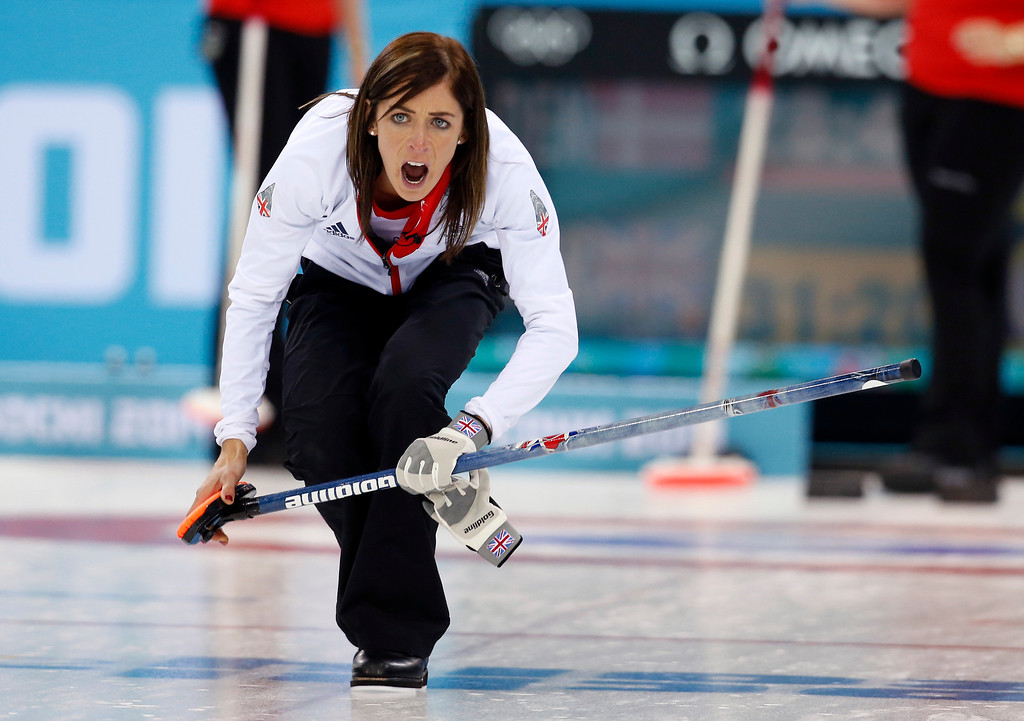 . Great Britain\'s skip Eve Muirhead shouts instructions to her sweepers after delivering the rock during women\'s curling competition against Denmark at the 2014 Winter Olympics, Monday, Feb. 17, 2014, in Sochi, Russia. (AP Photo/Robert F. Bukaty)