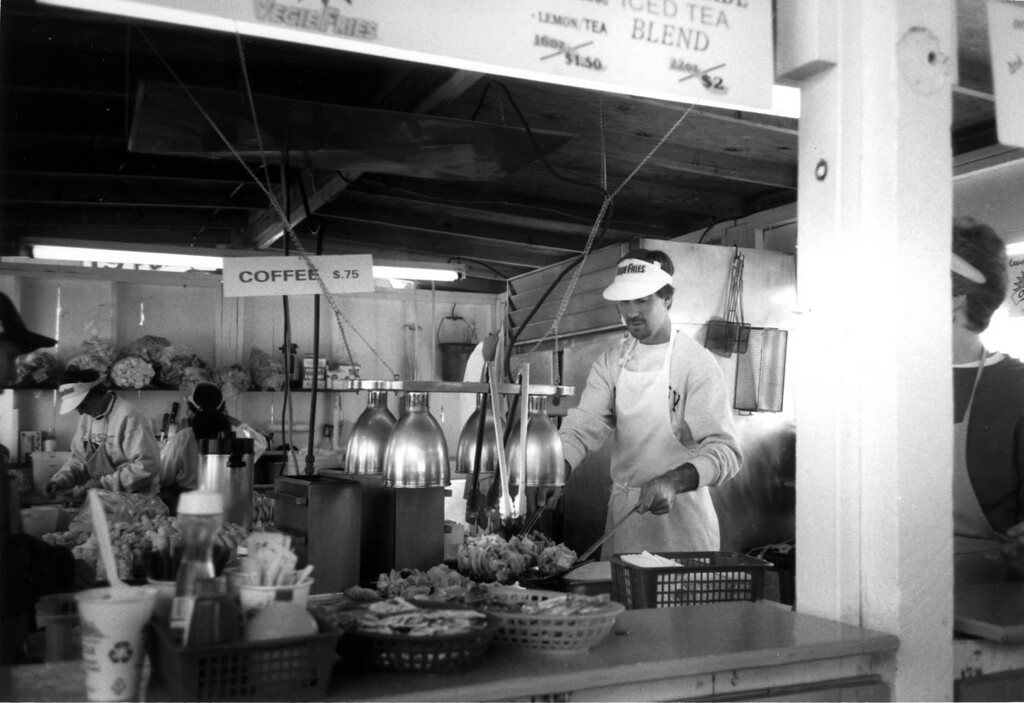 . A server dishes up baskets of veggie fries during the 1994 Minnesota State Fair. Photo courtesy of the Minnesota State Fair.