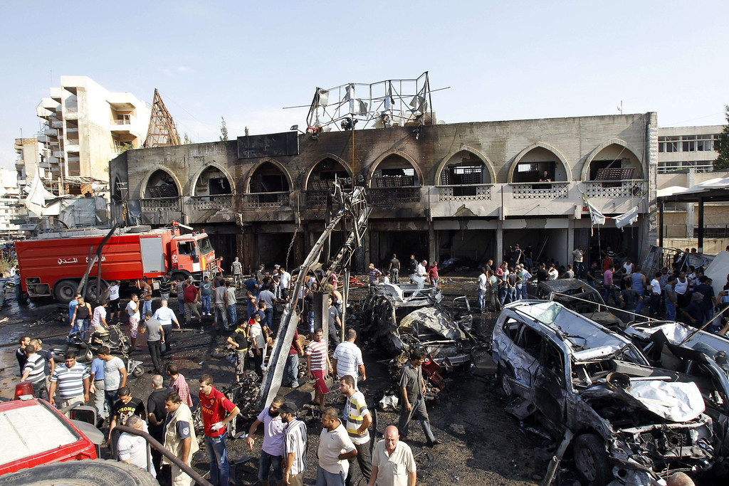 . Lebanese civilians gather at the site of a blast outside the Al-Taqwa mosque in the northern city of Tripoli on August 23, 2013.  AFP PHOTO/ANWAR AMRO/AFP/Getty Images