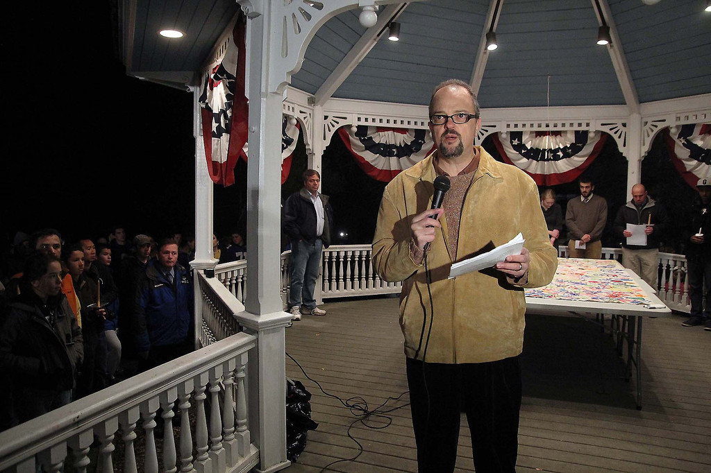 . Chairman of the Lunenburg Board of Selectman Tom Alonzo addresses the crownd thst showed up to the town gazebo in support of student Isaac Phillips on Sunday night. SENTINEL & ENTERPRISE/ JOHN LOVE