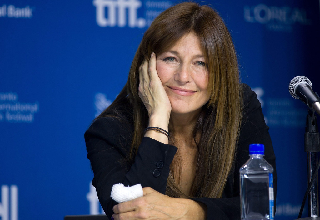 """. Actress Catherine Keener smiles during the press conference for \""""Enough Said\"""" at the 2013 Toronto International Film Festival in Toronto on Sunday, Sept. 8, 2013. (AP Photo/The Canadian Press, Galit Rodan)"""
