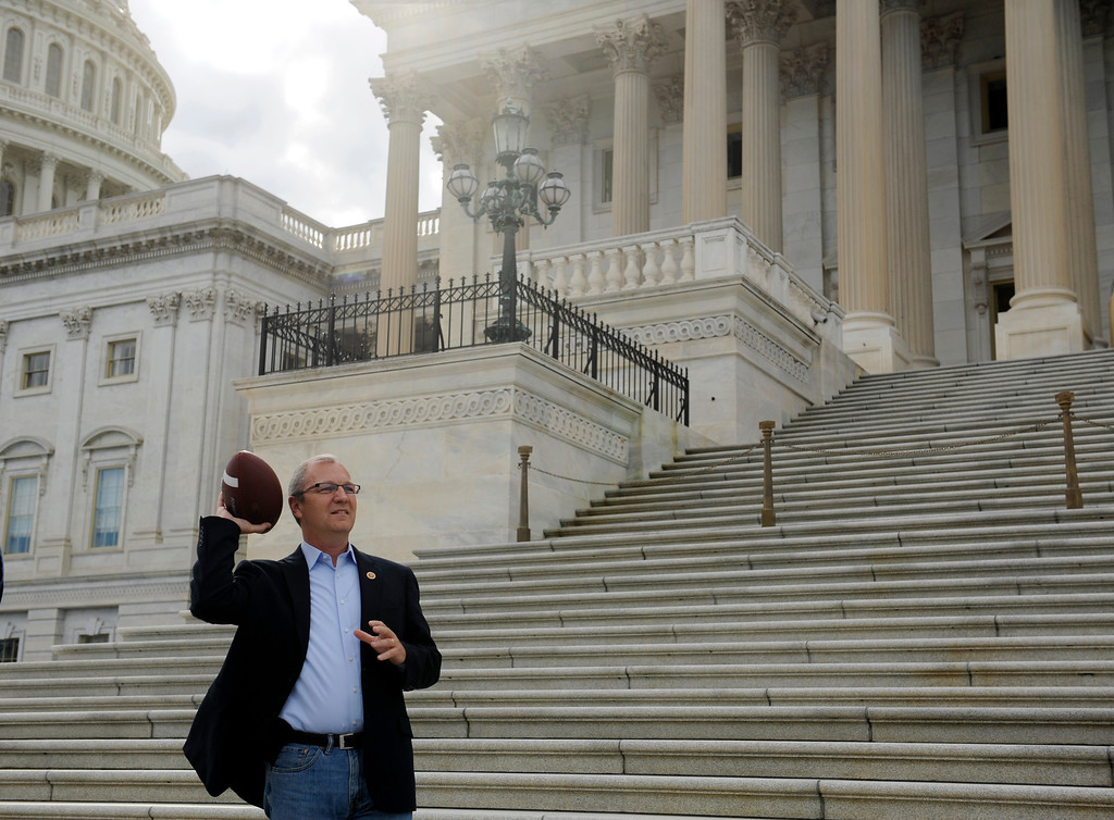 ". Rep. Kevin Cramer, R-N.D., throws a football while waiting for to join other Republican House Members to call on Senate Democrats to ""come back to work\"" on the Senate Steps of the U.S. Capitol, Sunday, Sept. 29, 2013 as the United States braces for a partial government shutdown Tuesday after the White House and congressional Democrats declared they would reject a bill approved by the Republican-led House to delay implementing President Barack Obama\'s health care reform. (AP Photo/Cliff Owen)"
