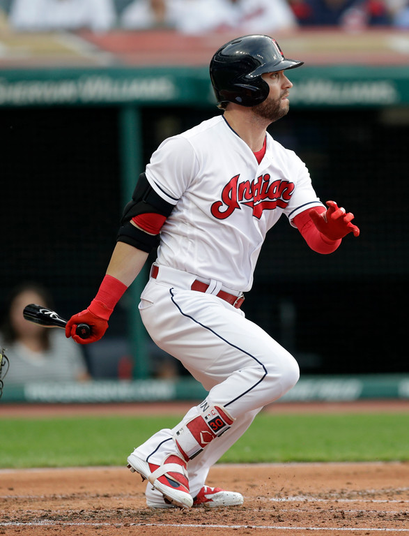 . Cleveland Indians\' Tyler Naquin hits a single in the second inning of a baseball game against the Minnesota Twins, Friday, June 15, 2018, in Cleveland. (AP Photo/Tony Dejak)