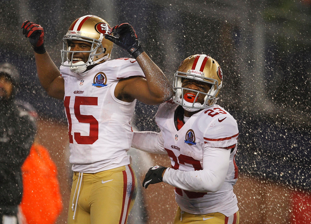 Description of . San Francisco 49ers wide receiver Michael Crabtree (L) celebrates his touchdown against the New England Patriots with 49ers team mate LaMichael James during the second half of their NFL football game in Foxborough, Massachusetts December 16, 2012. REUTERS/Jessica Rinaldi