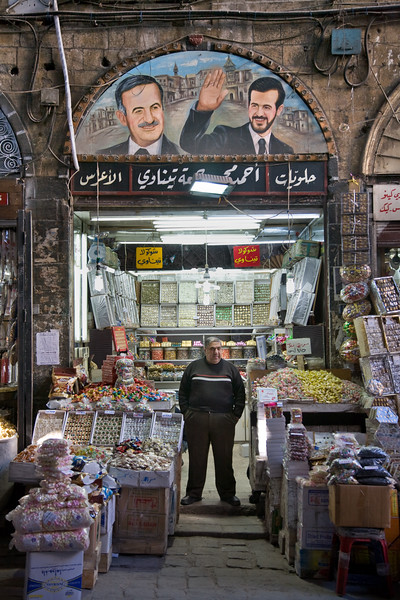 Damascus, Syria - January 2008: Mural of father and son - the former President Hafez al-Assad and his would be succesor Basil would died unexpectedly in a car crash in 1994. Ancient covered bazaar (souk) in downtown Damascus.  (Photo by Christopher Herwig)