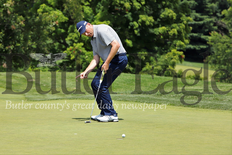 Rob McClellan of Butler tries to will his ball to break right on the eighth green during the Pittsburgh Open at the Sewickley Heights Golf Club Tuesday. McClellan entered the back nine one stroke behind the leaders before taking the lead in the final holes. Seb Foltz/Butler Eagle