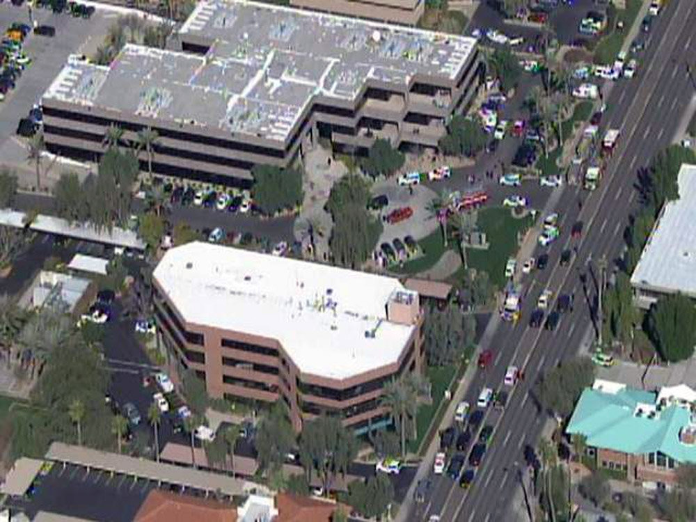 . This frame grab provided by abc15.com shows the scene at a Phoenix office complex where police say someone shot at least three people on Wednesday, Jan. 30, 2013. Officer James Holmes said the victims were taken to hospitals and did not know if their injuries were life threatening. (AP Photo/abc15.com)