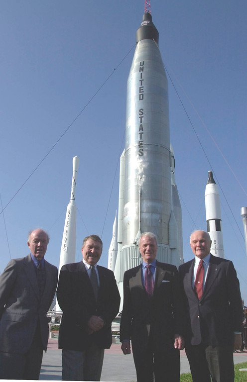 . The four surviving Mercury astronauts, from left, Gordon Cooper, Wally Schirra, Scott Carpenter and John Glenn stand in front of a Mercury Atlas rocket, center, at the Kennedy Space Center at Cape Canaveral, Fla., Sunday, Feb. 24, 2002. The men were on hand to celebrate 40 years of Americans in orbit. John Glenn was sent into orbit 40 years ago sitting atop a Mercury Atlas rocket. (AP Photo/Peter Cosgrove)
