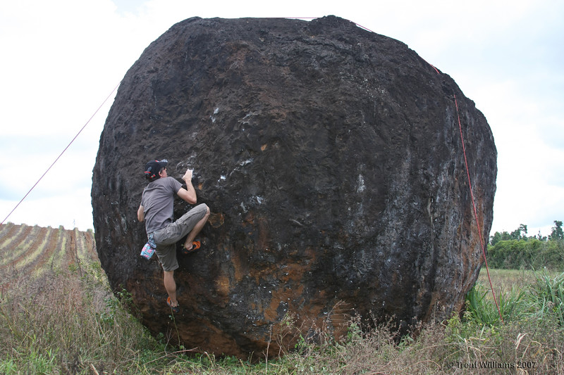 Craig bouldering at Nerada Rocks, Innisfail. He's climbing Tea Party (V2)