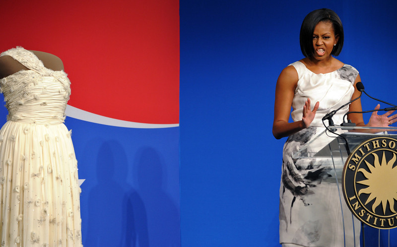 . US First Lady Michelle Obama speaks next to her 2009 inaugural gown during a ceremony at the Smithsonianís National Museum of American History in Washington, DC, on March 9, 2010. Continuing the long tradition of First Ladies donating their inaugural gowns to the Smithsonian, Michelle presented her 2009 inaugural gown to the Smithsonianís National Museum of American History. AFP PHOTO/Jewel SAMAD