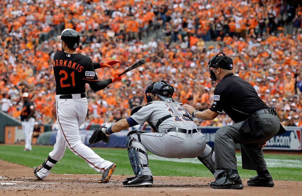 . Baltimore Orioles\' Nick Markakis watches his two-run home run in the third inning of Game 2 in baseball\'s AL Division Series against the Detroit Tigers in Baltimore, Friday, Oct. 3, 2014. (AP Photo/Patrick Semansky)