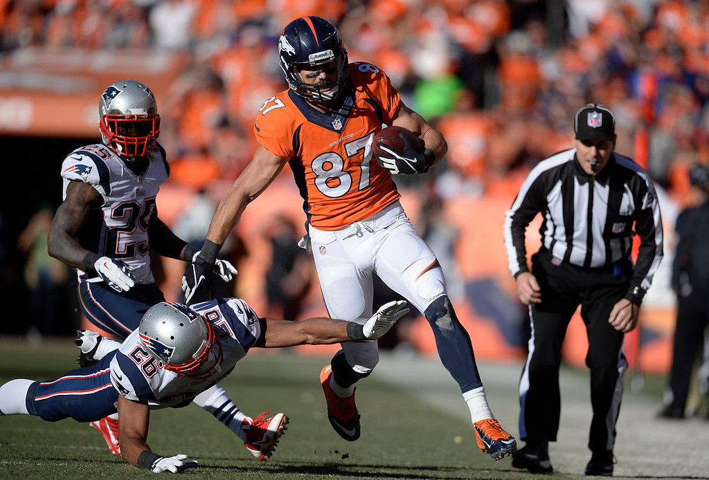 . Denver Broncos wide receiver Eric Decker (87) makes a first down in the third quarter. The Denver Broncos take on the New England Patriots in the AFC Championship game at Sports Authority Field at Mile High in Denver on January 19, 2014. (Photo by AAron Ontiveroz/The Denver Post)