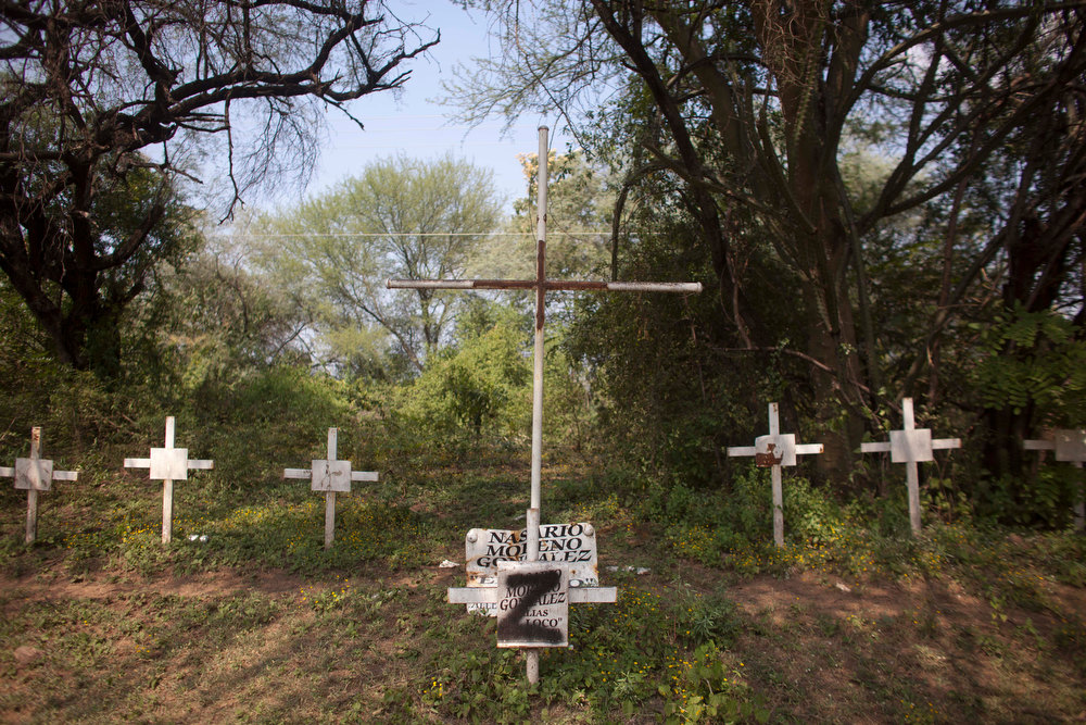 Description of . In this Oct. 24, 2012 photo, crosses allegedly left by the drug cartel