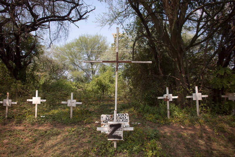 ". In this Oct. 24, 2012 photo, crosses allegedly left by the drug cartel ""Caballeros Templarios,\"" or Knights Templar, representing members of the drug cartel who have died, show signs of vandalism allegedly left by the Zetas drug cartel near the town of Cueramato, Michoacan state, Mexico. Knights Templar, a quasi-religious drug cartel that controls the area and most of the state, monitors the movements of the military and police around the clock. The gang\'s members not only live off methamphetamine and marijuana smuggling and extortion, they maintain country roads, control the local economy and act as private debt collectors for citizens frustrated with the courts, soldiers say.  (AP Photo/Alexandre Meneghini)"