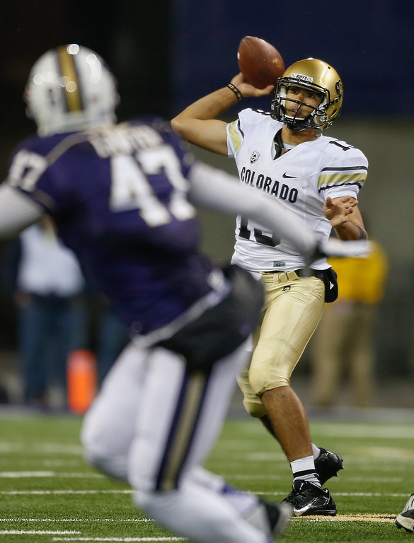 . Quarterback Sefo Liufau #13 of the Colorado Buffaloes passes against the Washington Huskies on November 9, 2013 at Husky Stadium in Seattle, Washington. The Huskies defeated the Buffaloes 59-7.  (Photo by Otto Greule Jr/Getty Images)