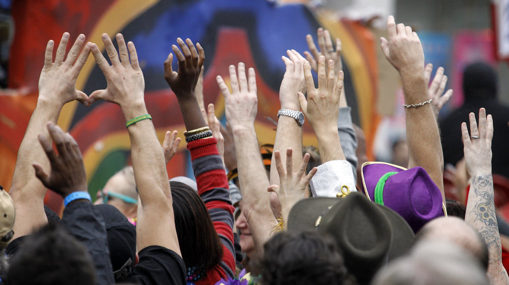 Description of . Revelers with out stretched hands plead for throws from riders in the Krewe of Zulu parade on Mardi Gras Day. Fat Tuesday, the traditional celebration on the day before Ash Wednesday and the begining of Lent, is marked in New Orleans with parades and marches through many neighborhoods in the city. (Photo by Rusty Costanza/Getty Images