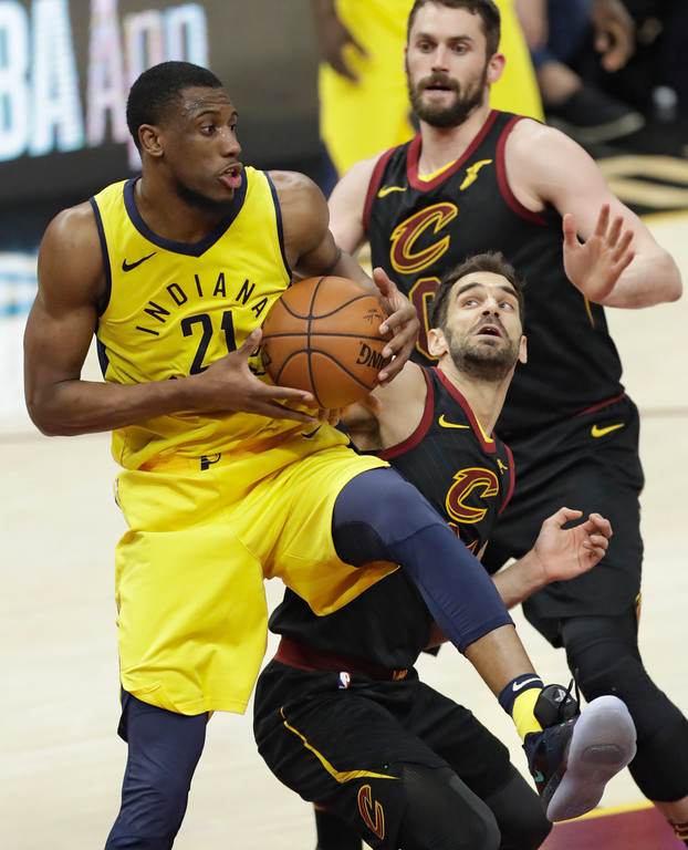 . Indiana Pacers\' Thaddeus Young (21) grabs a rebound ahead of Cleveland Cavaliers\' Jose Calderon (81), from Spain, in the second half of Game 5 of an NBA basketball first-round playoff series, Wednesday, April 25, 2018, in Cleveland. The Cavaliers won 98-95. (AP Photo/Tony Dejak)