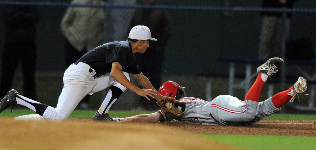 . LONG BEACH - 04/24/13 - (Photo: Scott Varley, Los Angeles Newspaper Group)  Long Beach Poly vs Lakewood in a Moore League baseball game at Blair Field. After a wild pitch, Lakewood\'s Andrew Mendoza is thrown out at third by Peter Fierros.