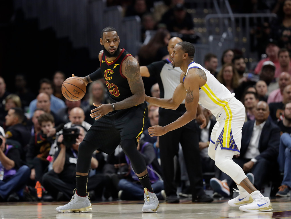 . Golden State Warriors forward Andre Iguodala (9) defends Cleveland Cavaliers forward LeBron James (23) in the first half of Game 3 of basketball\'s NBA Finals, Wednesday, June 6, 2018, in Cleveland. (AP Photo/Tony Dejak)