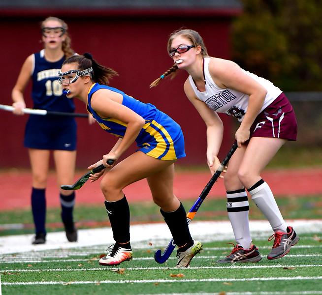 11/1/2018 Mike Orazzi | Staff Newington's Chloe Mamaclay (9) and Farmington's Dayna Deakin (19) during field hockey at Farmington High School Thursday.
