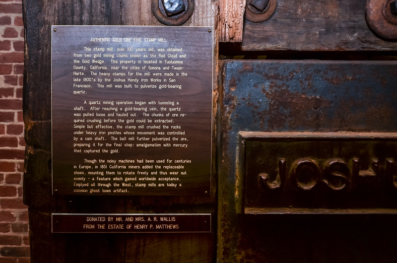 Plaque describing this authentic gold ore five stamp mill.