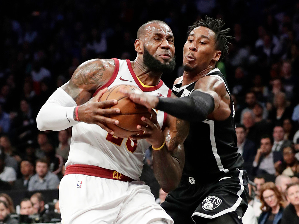 . Brooklyn Nets\' Rondae Hollis-Jefferson (24) defends Cleveland Cavaliers\' LeBron James (23) during the first half of an NBA basketball game Wednesday, Oct. 25, 2017, in New York. (AP Photo/Frank Franklin II)