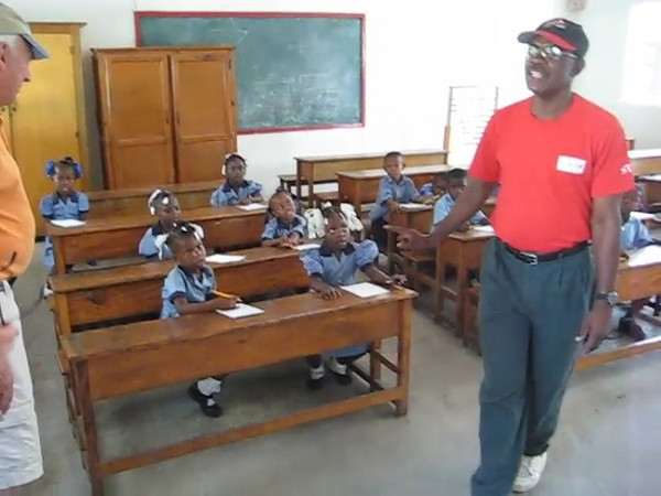 Pastor Leon de Orleans speaking to kindergarteners at the school founded by him and his wife Jacky  in Citi Soleil / Port au Prince.