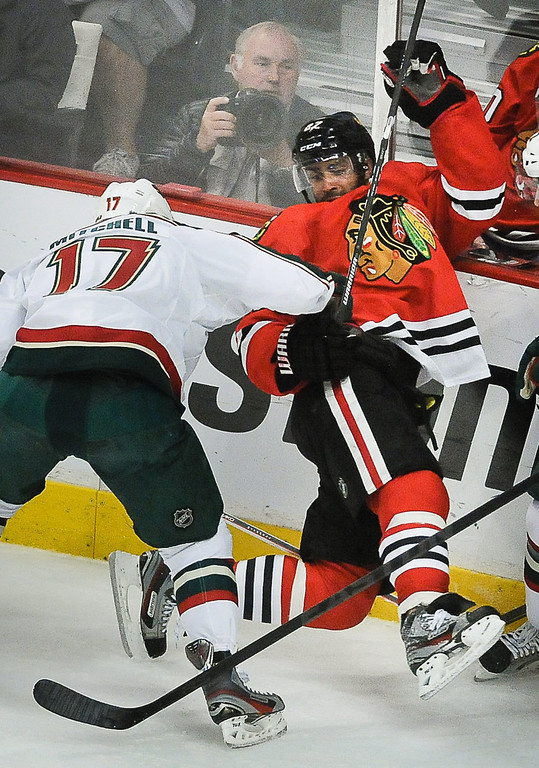 . Minnesota left wing Torrey Mitchell, left, checks Chicago defenseman Johnny Oduya in the first period as the Minnesota Wild play the Chicago Blackhawks in Game 5. (Pioneer Press: Ben Garvin)