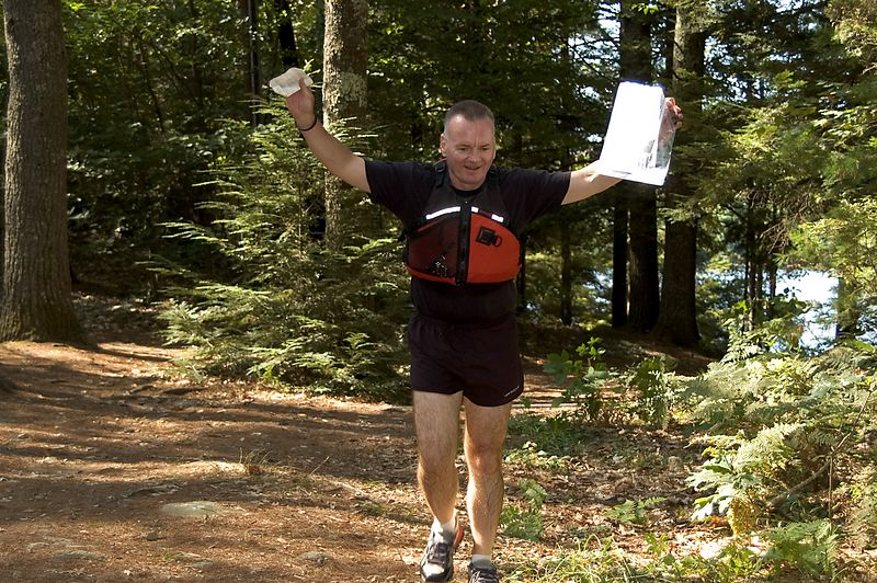 Don Campbell runs to the Canoe-O finish