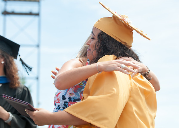 06/19/18 Wesley Bunnell | Staff New Britain High School graduating senior Luz Jimenez receives her diploma and a hug from teacher Mrs. Wild-Jones during graduation exercises at Veterans' Memorial Stadium at Willow Brook Park on Tuesday morning.