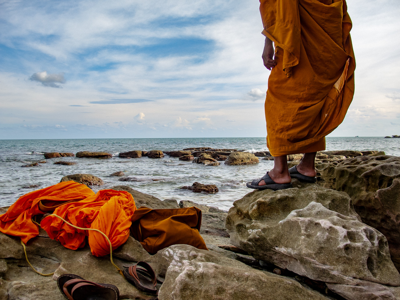 Monk Swimming on Serendipity Beach in Sihanoukville, Cambodia