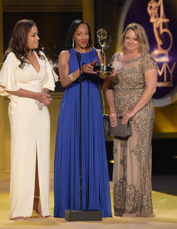 ". Sunny Hostin, from left, Lisa Sivertsen and Sabina Ghebremedhin accept the award for outstanding morning program for ""Good Morning America\"" at the 45th annual Daytime Emmy Awards at the Pasadena Civic Center on Sunday, April 29, 2018, in Pasadena, Calif. (Photo by Richard Shotwell/Invision/AP)"