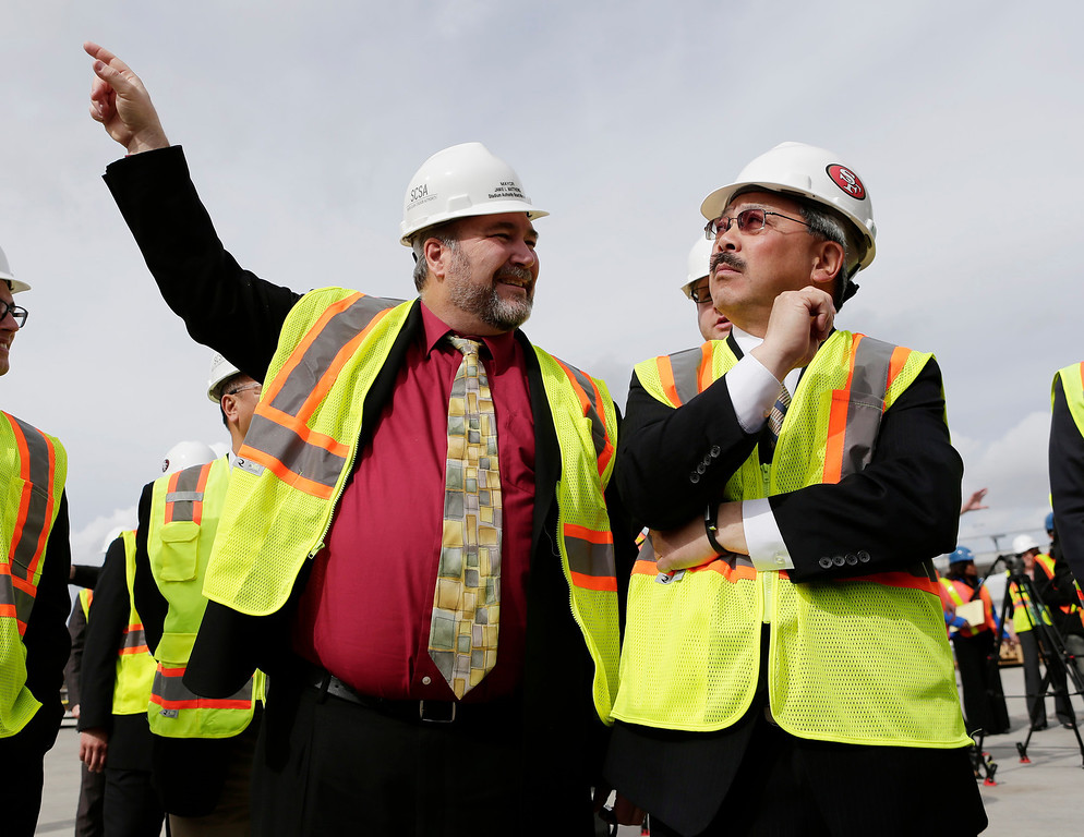 . Santa Clara Mayor Jamie Matthews points out stadium features to San Francisco Mayor Ed Lee before a press conference at the construction site of the new 49ers stadium in Santa Clara, Calif. on Wednesday, March 6, 2013. The Super Bowl Host Committee is competing against Miami for the bragging rights of hosting the 50th Super Bowl in 2016.  (Gary Reyes/ Staff)