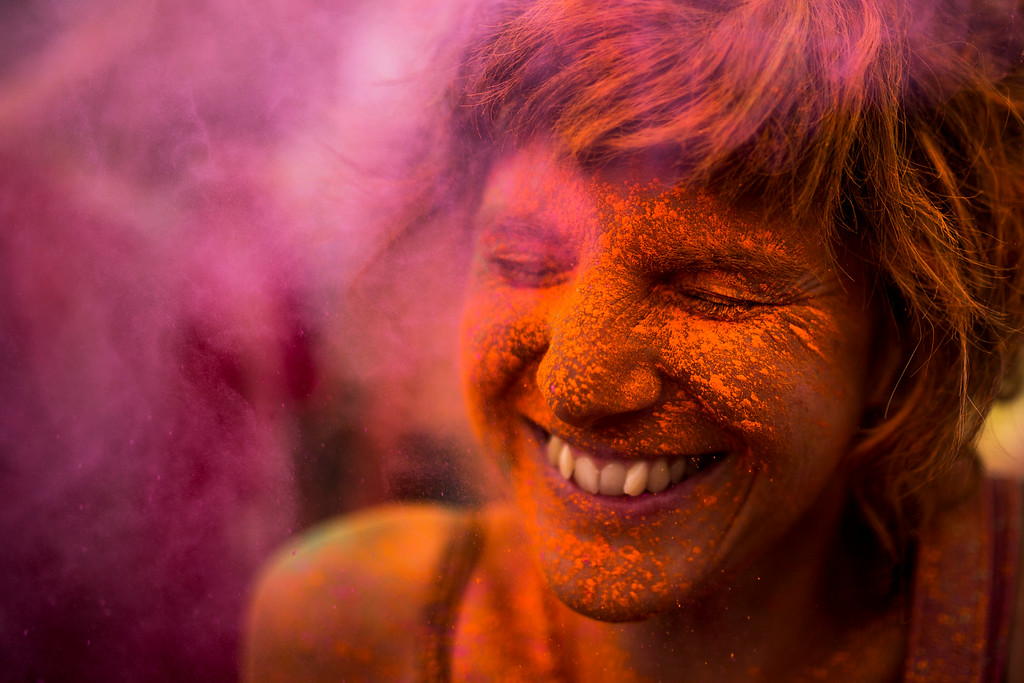 . A reveler is covered in colored powder,  during a Monsoon Holi Festival in Madrid, Spain, Saturday, Aug. 9, 2014.  (AP Photo/Andres Kudacki)
