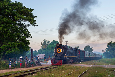 YD #967 enters Hnin Pale Station at dusk with down mixed train 86
