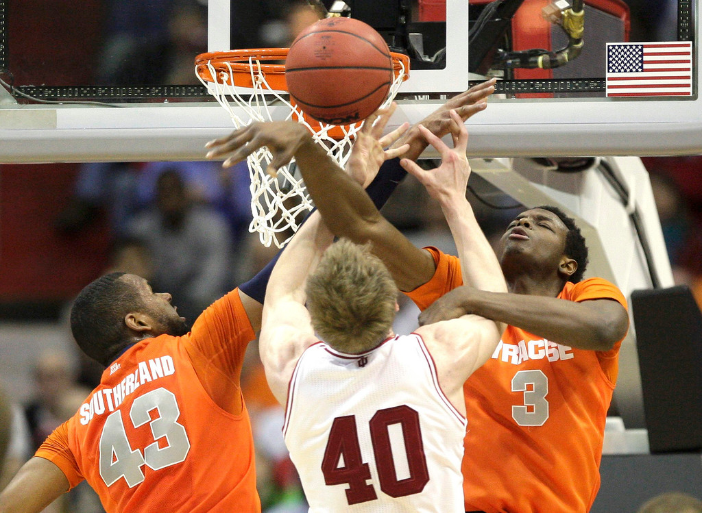 . Indiana Hoosiers forward Cody Zeller (40) is double teamed by Syracuse Orange forward James Southerland (L) and forward Jerami Grant during the first half in their East Regional NCAA men\'s basketball game in Washington, March 28, 2013. REUTERS/Jonathan Ernst