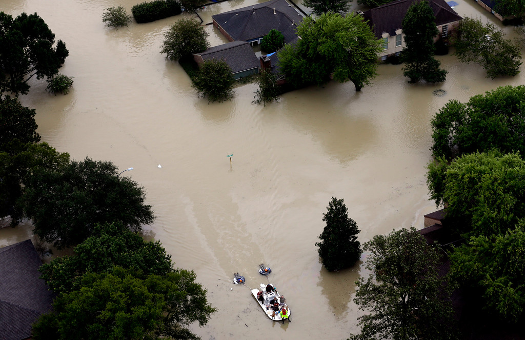 . Residents evacuate their homes near the Addicks Reservoir as floodwaters from Tropical Storm Harvey rise Tuesday, Aug. 29, 2017, in Houston. (AP Photo/David J. Phillip)