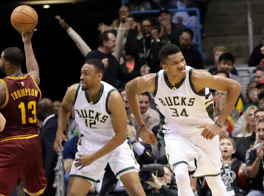 . Milwaukee Bucks\' Giannis Antetokounmpo reacts after making a dunk during the first half of an NBA basketball game against the Cleveland Cavaliers Tuesday, Nov. 29, 2016, in Milwaukee. (AP Photo/Morry Gash)