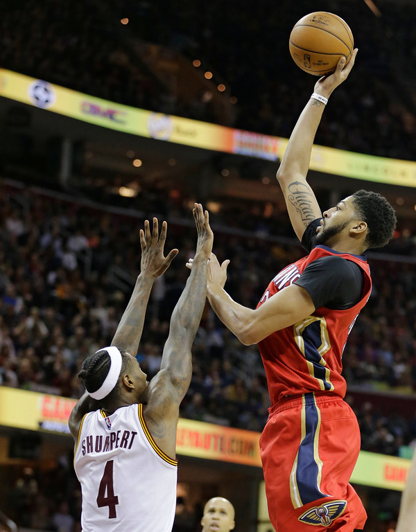 . New Orleans Pelicans\' Anthony Davis, right, shoots against Cleveland Cavaliers\' Iman Shumpert in the second half of an NBA basketball game, Monday, Jan. 2, 2017, in Cleveland. The Cavaliers won 90-82. (AP Photo/Tony Dejak)