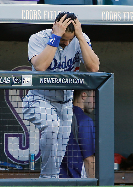 . Los Angeles Dodgers center fielder Andre Ethier holds his head in his hands during the seventh inning of a baseball game against the Colorado Rockies Wednesday, Sept. 17, 2014, in Denver. (AP Photo/Jack Dempsey)