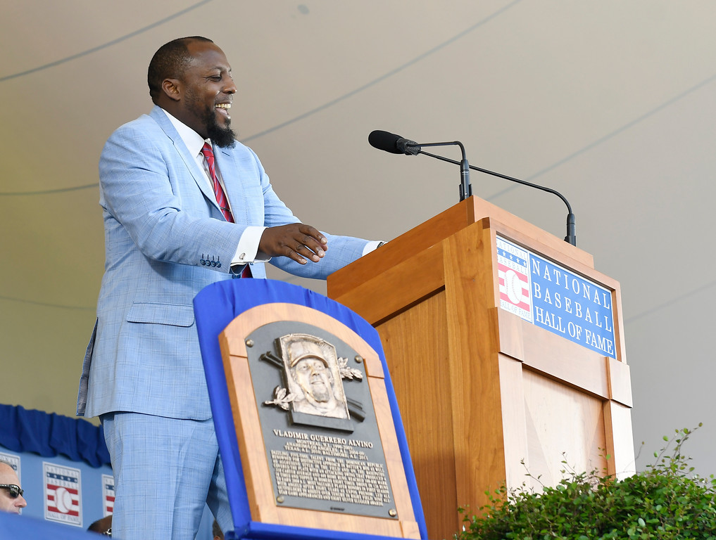 . National Baseball Hall of Fame inductee Vladimir Guerrero speaks during an induction ceremony at the Clark Sports Center on Sunday, July 29, 2018, in Cooperstown, N.Y. (AP Photo/Hans Pennink)