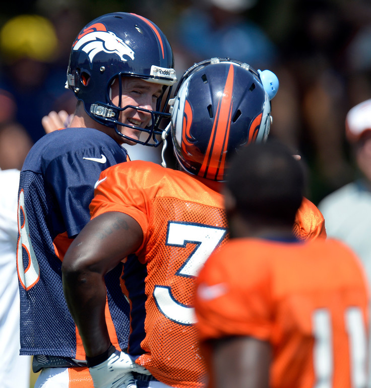 . Denver Broncos quarterback Peyton Manning (18) talks with RB Montee Ball (38) during practice August 20, 2013 at Dove Valley (Photo by John Leyba/The Denver Post)