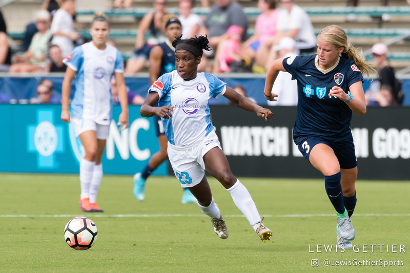 Jasmyne Spencer (23)  and Makenzy Doniak (3) during a match between the NC Courage and the Orlando Pride in Cary, NC in Week 3 of the 2017 NWSL season. Photo by Lewis Gettier.