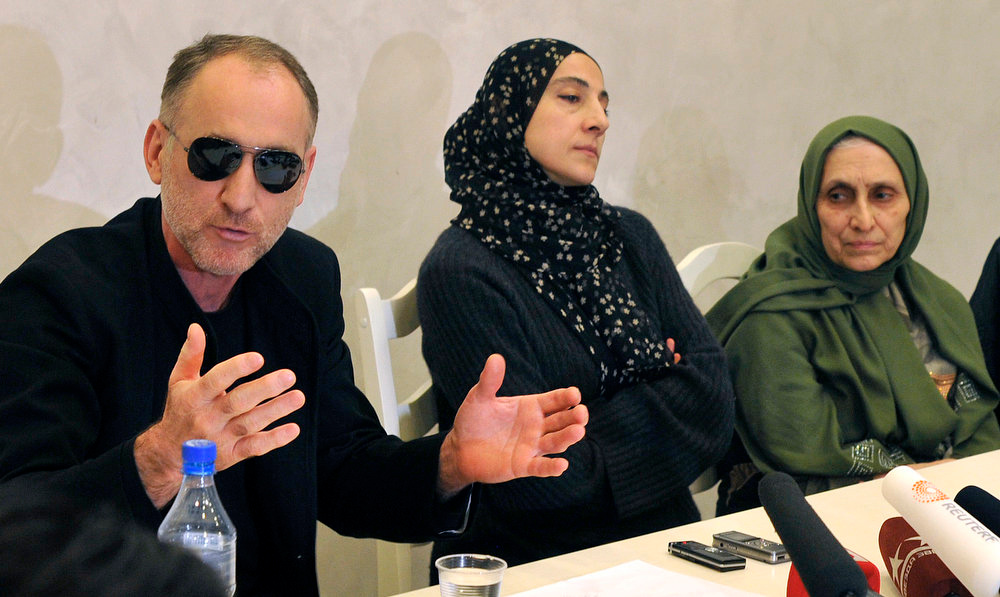 . The father of the two Boston bombing suspects, Anzor Tsarnaev, left, with the suspects\' mother  Zubeidat Tsarnaeva, center, speaks at a news conference in Makhachkala, the southern Russian province of Dagestan, Thursday, April 25, 2013. The father of the two Boston bombing suspects said Thursday that he is leaving Russia for the United States in the next day or two, but their mother said she was still thinking it over. At right is Tsarnaeva  sister-in-law Maryam. (AP Photo/Sergei Rasulov, NewsTeam)