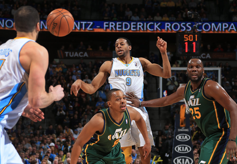 . Andre Iguodala #9 of the Denver Nuggets passes the ball to Kosta Koufos #41 of the Denver Nuggets against the defense of Randy Foye #8 of the Utah Jazz and Al Jefferson #25 of the Utah Jazz at the Pepsi Center on January 5, 2013 in Denver, Colorado. (Photo by Doug Pensinger/Getty Images)
